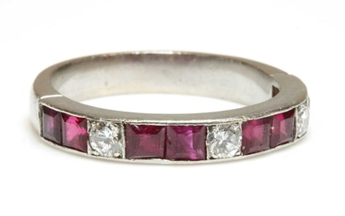 A diamond and ruby half eternity ring