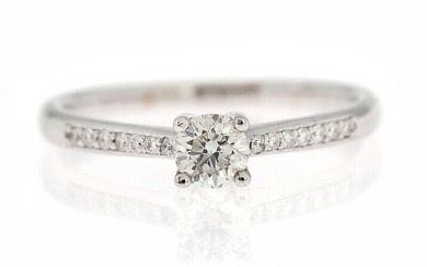 A diamond ring set with a brillant-cut diamond weighing app. 0.33 ct. flanked by numerous...