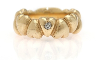 A diamond ring set with a brilliant-cut diamond weighing app. 0.06 ct., mounted in 14k...