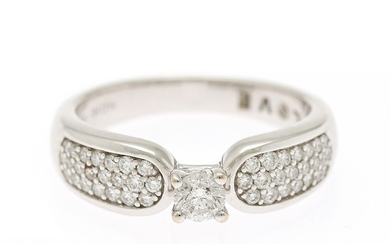 A diamond ring set with a diamond weighing app. 0.20 ct. flanked by numerous diamonds, totalling app. 0.50 ct., mounted in 14k white gold. F-G/VS-SI. Size 52.5.