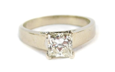 A diamond solitaire ring, set with a princess cut...