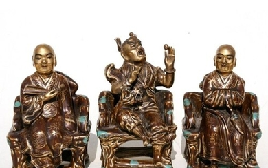 A group of three Chinese glazed pottery robed figures seated...