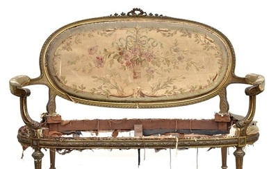 A late 19th century French giltwood open arm sofa, in need o...