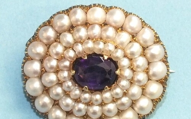 A late-Victorian amethyst and pearl brooch claw-set an oval ...