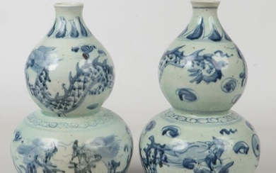 A pair of 20th century Chinese blue and white double gourd v...