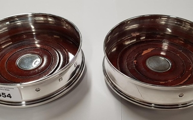 A pair of English silver Coasters.