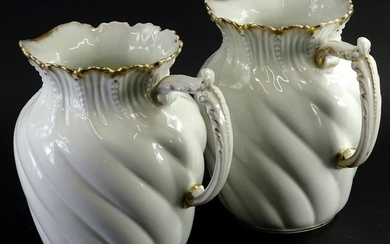 A pair of Limoges porcelain wash jugs, each with wrythen dec...