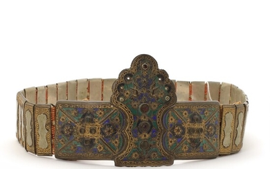 A partial gilt and enamel metal wedding belt decorated with rhinestones. Cast with ornaments and double eagle. Greece. 19th century. L. 95 cm.