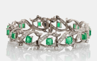 A platinum bracelet set with step-cut emeralds with a total weight of ca 12.50 cts