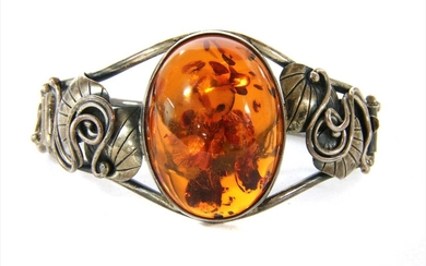 A sterling silver hinged amber bangle