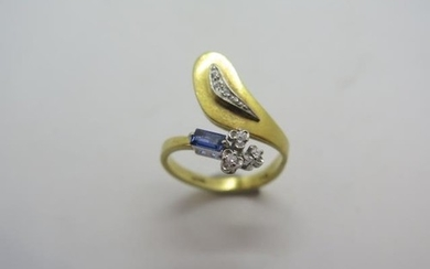 A unique 18ct diamond and sapphire ring, marked 750, No 1035...