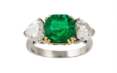 AN EMERALD AND DIAMOND THREE STONE RING, the octagonal cut e...