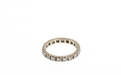 American wedding band in 18 K (750°/°°) white gold set with 20 brilliant-cut diamonds.
