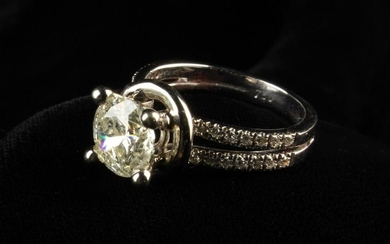 An 18 Carat White Gold and 2.1 Carat Diamond Ring. The round brilliant cut stone raised on a four c