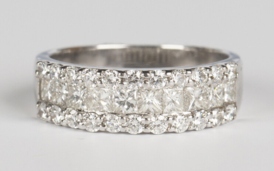An 18ct white gold and diamond half eternity ring, mounted with a row of princess cut diamonds betwe
