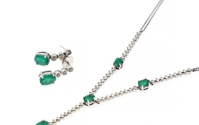 An emerald and diamond jewellery set comprising a necklace and a pair of ear pendants set with emeralds and diamonds, mounted in 18k white gold.