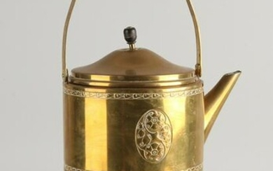 Antique brass tea pot on a stove.&#160 Germany, WMF