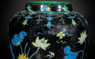 Chinese Art. A large fahua jar over blue ground China, Qing dynasty, 19th century or earlier. Decorated with animal motif and marshy vegetation in lively polychromy on a dark blue ground. The vase presents the interior with bright green glaze. It is...