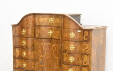 Crossbow-shaped cabinet with 15 drawers and a central...