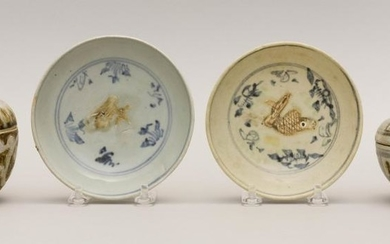 """FOUR PIECES OF SOUTHEAST ASIAN STONEWARE Two underglaze blue and bisque fish-pattern dishes, diameters 5"""", a Sawankhalok covered jar..."""