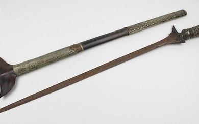 Long kris dagger, Indonesia, Sumatra probably 19th century, with straight blade (kris lurus), this rusty and somewhat jagged, wavy ganja (damaged), pommel entirely covered with silver, elaborately decorated with engraved scale pattern and soldered...