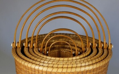 Nest of Eight Bill and Judy Sayle Round Open Swing Handle Nantucket Baskets, 1983
