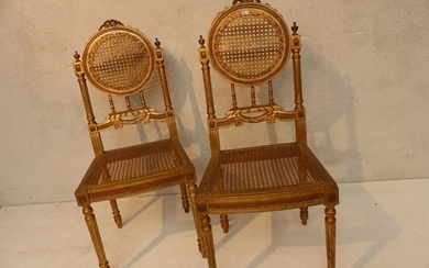 Pair of Louis XVI style chairs in gilded and carved wood.