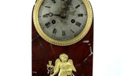 Red Morello cherry marble and gilt bronze clock, with applied decoration of a love, surmounted by a bust of Hermes.