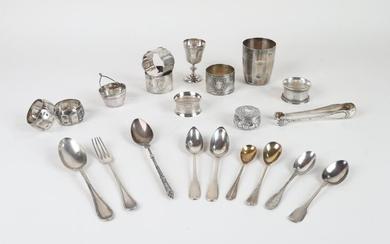 SILVER (lot of): seven napkin rings, a kettledrum, an egg cup, a pill box, various small spoons including one from the 18th century, tea strainer and sugar tongs. Weight 580 g