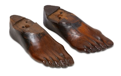 TREEN: A PAIR OF 19TH CENTURY CARVED FRUITWOOD RIGHT FEET