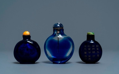 Three Chinese transparent blue glass snuff bottles, one...