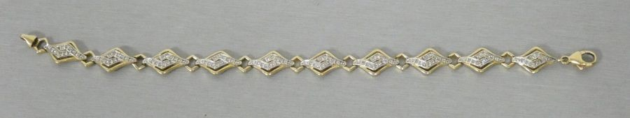 Yellow gold bracelet paved with diamonds in a...