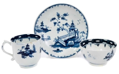 18th century Lowestoft blue and white porcelain tea trio, decorated with a chinoiserie pattern, the saucer with a variant border pattern