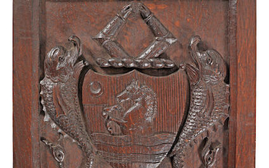 A 19th century carved oak armorial panel, English