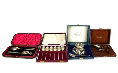 A COLLECTION OF CASED SILVER ITEMS To include an egg cup and...