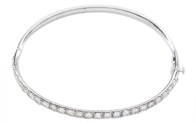 A DIAMOND BANGLE - The hinged bangle set with twenty five round brilliant cut diamonds totalling 4.25cts, in 18ct white gold, 12.6GMS