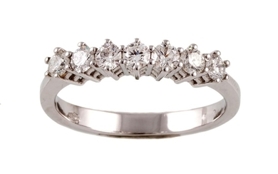 A DIAMOND HALF ETERNITY RING, with diamonds of 0.62ct in tot...
