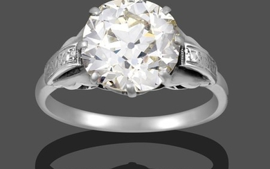 A Diamond Solitaire Ring, the old cut diamond in a...