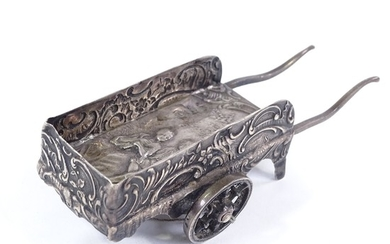 A Dutch silver miniature novelty cart, relief embossed lover...