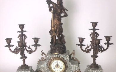 A FRENCH THREE PIECE GILT METAL FIGURAL CLOCK GARNITURE With...