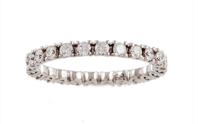 A FULL BANDED DIAMOND ETERNITY RING, set with brilliant cut ...