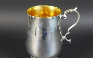 A George V silver tankard, of baluster form with scroll hand...