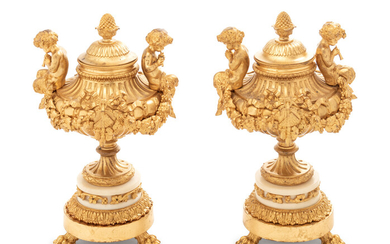 A Pair of Louis XV Style Gilt Bronze and White Marble Covered Urns