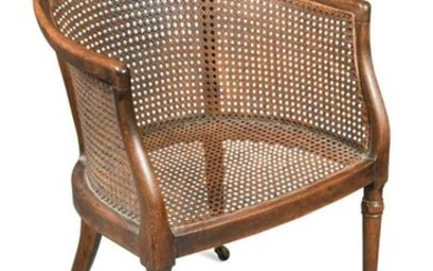 A Regency mahogany caned library bergere tub chair…