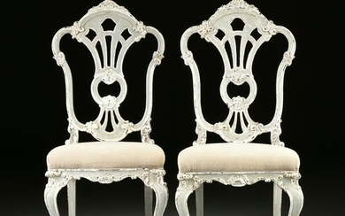 A SET OF EIGHT ITALIAN ROCOCO STYLE PAINTED AND CARVED