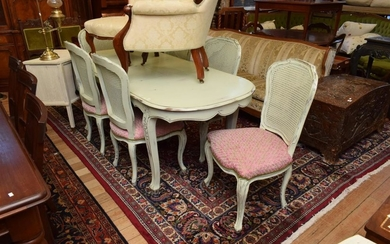 A SEVEN PIECE SETTING INCLUDING FRENCH STYLE EXTENSION DINING TABLE AND MATCHING SET OF SIX SHABBY CHIC CHAIRS WITH RATTAN BACK AND...
