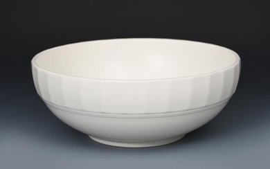 A Wedgwood Moonstone bowl designed by Keith Murray,...