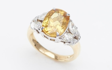 A YELLOW SAPPHIRE AND DIAMOND RING-The oval cut yellow sapphire weighing 5.02cts, shouldered by marquise cut diamonds totalling 0.90...