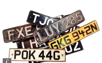 A collection of early and later vehicle license plates to in...