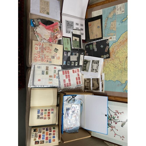 A collection of first day covers and various stamps from aro...